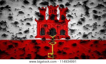 Flag of Gibraltar painted on wall with bullet holes