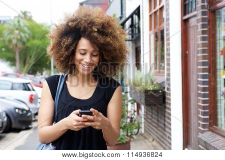 Happy Black Woman Walking And Reading Text Message