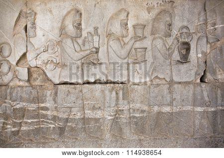 Stone Bas-relief With Images Of People Of Historical Persepolis, Iran.