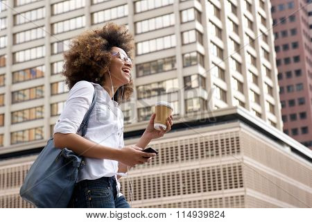 Happy Young Woman Listening To The Music