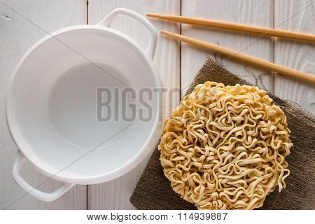 Empty Bulonnitsa Near Instant Noodles And Chopsticks On A White Background