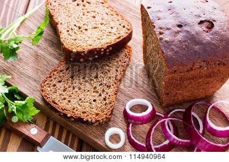 Black Bread With Bran And Red Onion And Parsley Selective Focus