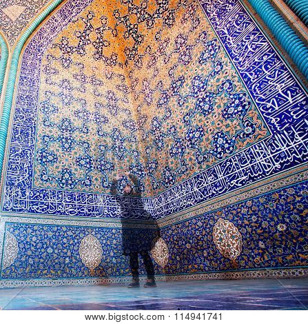 Women Make Photo Pictures In Blue And Yellow Colors Mosque With Tiles On Walls