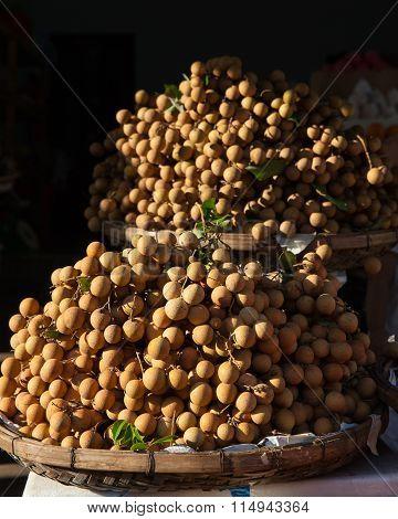 Baskets full of tropical longan fruit