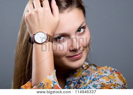 Close-up Portrait Of Young Beautiful Girl With A Wristwatch