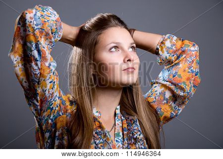 Portrait Of Dreaming Beautiful Girl With Bright Colored Blouse Looking Up To The Side