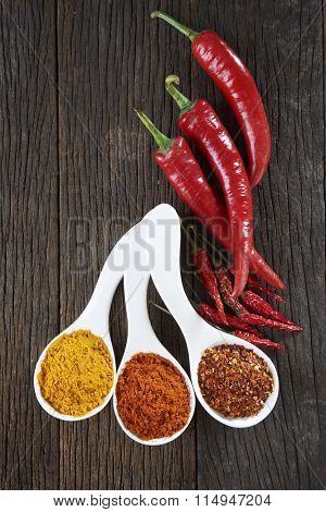 chili ,chili powder and curry leaf on the wooden background