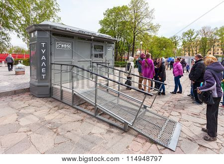 People Stand In A Queue Near The Public Toilet In Samara, Russia