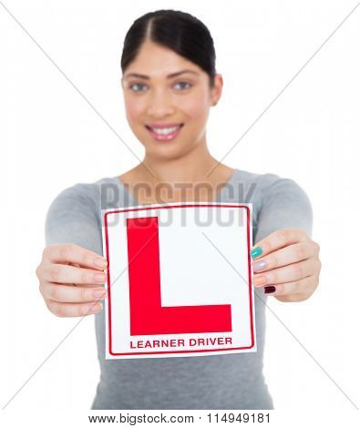 happy young woman presenting learner driver sign