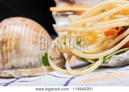 Italian Spaghetti And Clams In A Large Shell