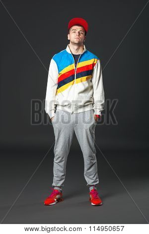 Full body Portrait Of Young Cool Man Standing  On Dark Background.
