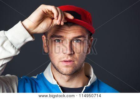 Portrait Of Cool Looking Young Guy Posing In Studio.