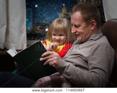 Father daughter reading a book