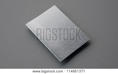 Notebook with leather cover on the gray background. 3d render