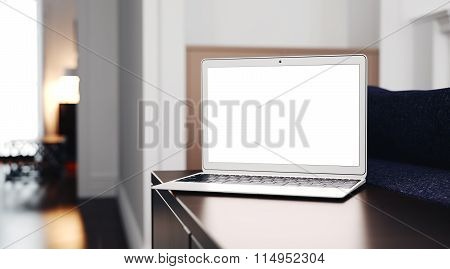 Generic design laptop on the table in modern interior. Focus at computer. 3d render