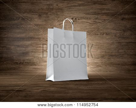 Concept of blank white shopping bag wooden background. Focus on the bag. 3d render
