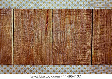 Wooden background with ribbon.