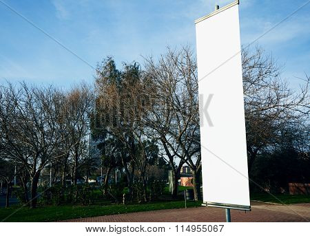 Empty vertical banner on the city square.