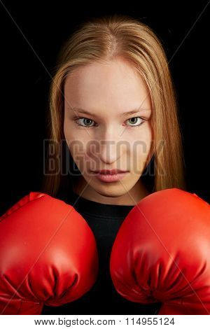 Young woman learning self-defense with red boxing gloves