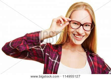 Smiling young blonde woman with hands on her glasses