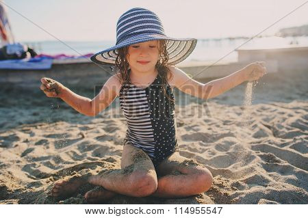 happy child in swimsuit relaxing on the summer beach l