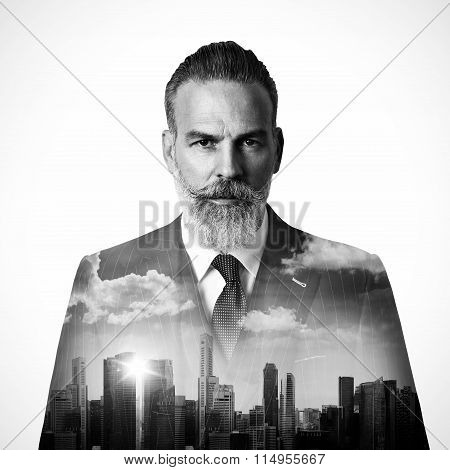 Close-up portrait of stylish businessman and the city. Black white