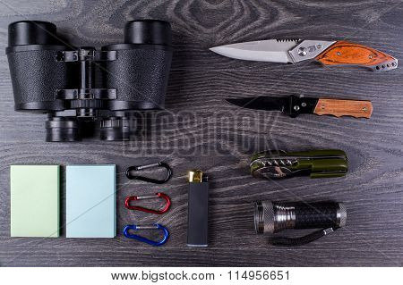 The field-glass, spoon, fork, knives, the smartphone, lighter, carbines, tourist equipment