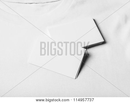 Closeup of set business cards on white tshirt. Horizontal