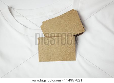 Closeup of blanks craft business cards on white tshirt