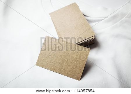 Closeup of blanks craft business cards on white tshirt. Horizontal