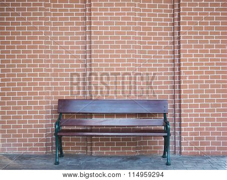 Wooden Bench And Brick Wall