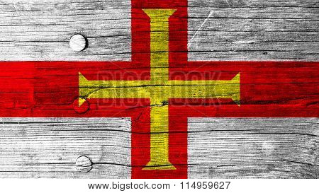 Flag of Guernsey painted on wood