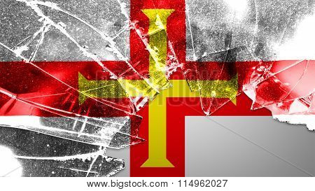 Flag of Guernsey painted on broken glass
