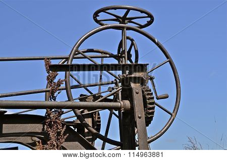 Gears and wheels of an old road grader