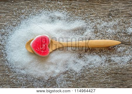 Jelly Sweet Heart Shape In Spoon On Sugar Background.