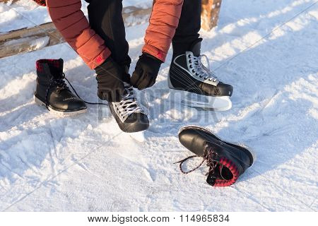 Man Wears A Winter Skates At The Rink