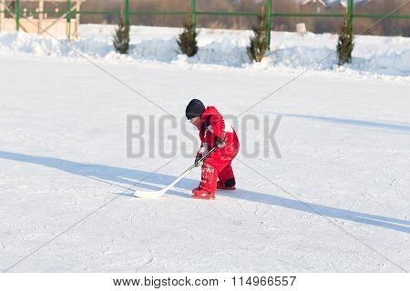 Happy Funny Kids Playing Hockey At The Rink