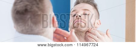 Man Scratching Beard