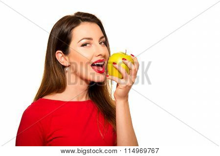 Positive Female Biting A Big Green Apple Fruit Smiling On White Background