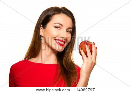 Positive Female Biting A Big Red Apple Fruit Smiling On White Background Looking At Camera