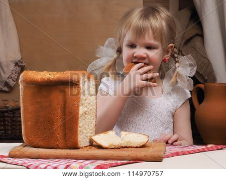 Child eating freshly baked bread