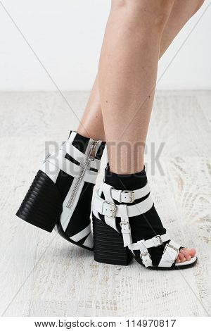 Woman's Feets In The Stylish Black And White Shoes