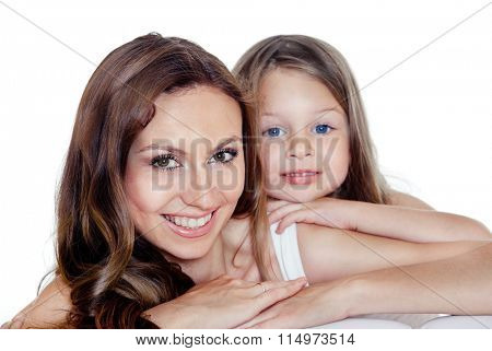 Portrait of young beautiful smiling mother and preschool daughter with blue eyes