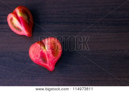 Heart Shaped Tomatos On Wooden Table