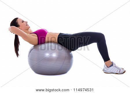 Slim Woman In Sports Wear Doing Exercises On Fitness Ball Isolated On White