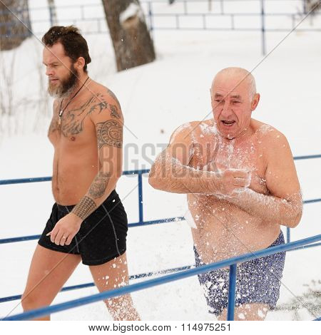Orel, Russia - January 19, 2016: Russian Epiphany Feast. Undressed Senior Man Rubbing Himself