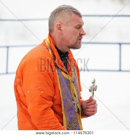 Orel, Russia - January 19, 2016: Russian Epiphany Feast. Orthodox Priest Blessing Water
