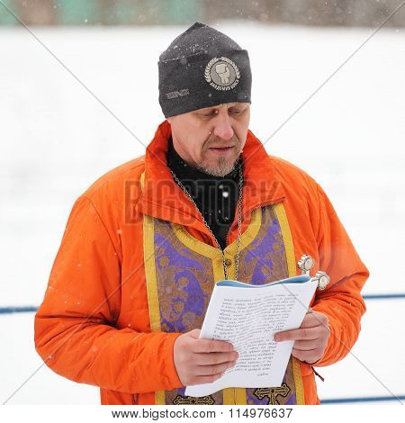 Orel, Russia - January 19, 2016: Russian Epiphany Feast. Orthodox Priest Reading Prayer For Blessing