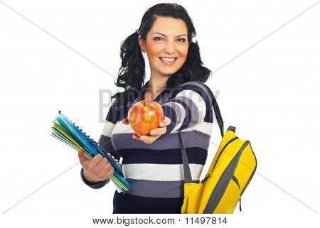 Happy Student Giving An Apple