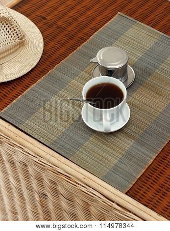 Morning Coffee Served In Vietnam Coffee Filter On Rattan Table, Natural Light Photo